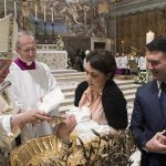 Pope Francis baptizes an infant Jan. 7 in the Vatican's Sistine Chapel. (CNS photo/L'Osservatore Romano) See POPE-AUDIENCE-BAPTISM-SEAL May 9, 2018.